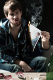 Angry man. Young angry men destroying photo of his ex-girlfriend Stock Photo