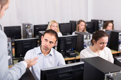 Angry manager displeased of employees stock image