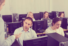 Angry manager displeased of employees stock images