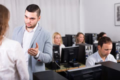 Angry manager displeased of employees stock photos