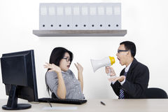 Angry manager and secretary with megaphone Royalty Free Stock Images