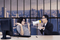 Angry manager with secretary near the window Royalty Free Stock Images