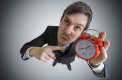 Angry manager is showing clock. Discipline concept. View from top Royalty Free Stock Photos