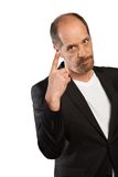 Angry Manager. An angry Manager shows a be careful sign with his fingers Stock Image