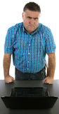 Angry manager, work problems. Angry manager in front of his laptop Stock Photos
