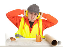 Angry manual worker with blueprints Stock Image