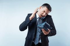 Angry mature businessman yelling at partner on phone Royalty Free Stock Photo