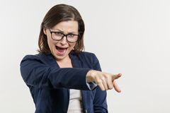 Angry mature business woman screaming, white studio background. Angry mature businesswoman screaming, white studio background Royalty Free Stock Images