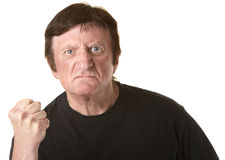 Angry Mature Man. Angry mature Caucasian man with clenched fist over white background Royalty Free Stock Photos
