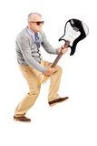 Angry mature man breaking an electric guitar. Full length portrait of an angry mature man breaking an electric guitar isolated on white background Royalty Free Stock Image