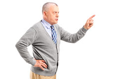Angry mature man pointing with finger and threatening. Isolated on white background royalty free stock image