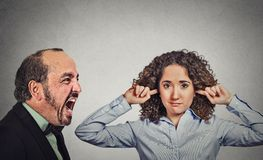 Angry mature man screaming at his young wife woman Royalty Free Stock Photo