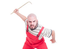 Angry mechanic beeing aggressive with a big crowbar Stock Image