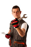 Angry mechanic threats with wrench Royalty Free Stock Images