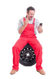 Angry mechanic yelling or shouting on video call stock photo