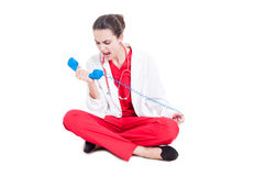 Angry medic woman screaming on telephone. Receiver as conflict concept isolated on white Royalty Free Stock Images