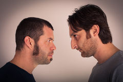Angry men. Showdown between two business men Royalty Free Stock Image