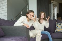 Angry man feeling indignant about girlfriend complaining of bad. Angry men feels indignant about hysterical girlfriend complaining of bad relationships stock image
