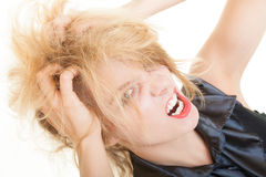 Angry messy business woman screaming with mouth wide open. Trouble in work. Royalty Free Stock Photography