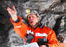 Angry mine worker. With helmet royalty free stock image
