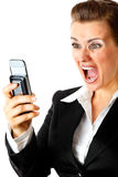 Angry modern business woman shouting on phone. Angry modern business woman shouting on mobile phone isolated on white Royalty Free Stock Images