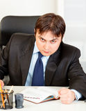 Angry modern businessman banging fist on table Stock Images