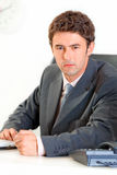 Angry modern businessman banging fist on table Stock Image