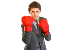 Angry modern businessman with boxing gloves Royalty Free Stock Image