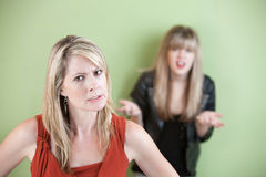 Angry Mom. Angry mother with frustrated daughter in the background Royalty Free Stock Photos