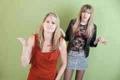 Angry Mom. Mom unhappy with daughter's provocative clothing Royalty Free Stock Photography