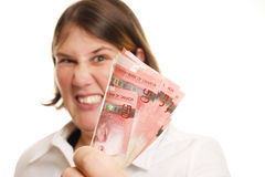 Angry Money Lady. Out of Focus angry lady holding a fist full of Canadian Fifty dollar bills Royalty Free Stock Photos