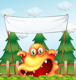 An angry monster below the empty banner Stock Photos