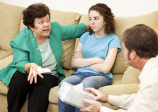 Angry Mother and Daughter Therapy. Angry mother complains about her teenage daughter in family therapy Royalty Free Stock Photography