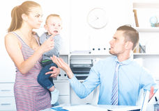 Angry mother quarreling with adult banker Stock Image