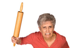 Angry mother and rolling pin Royalty Free Stock Images