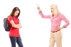 Angry mother shouting at her daughter Stock Photo