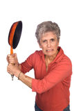 Angry mother swinging a frying pan Stock Photography