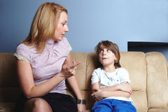 Angry mother talks to her son Stock Photos