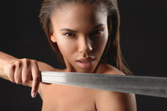 Angry mulatto girl threatening by machete Royalty Free Stock Photo