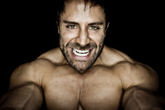 Angry muscled bodybuilding man Royalty Free Stock Photos