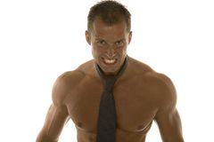 Angry muscular businessman. Muscular male body builder posing as angry businessman stock photography