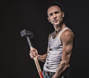 Angry muscular man with hammer Royalty Free Stock Photo