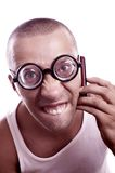 Angry nerd talking on a cell phone Stock Photo