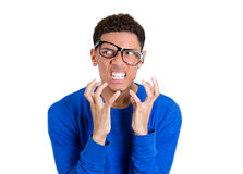 Angry nerdy man with hands raised, glasses messed up, clenching teeth Stock Images