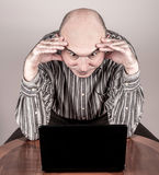Angry and nervous businessman with a laptop Stock Images
