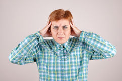 Angry and nervous woman. With hands on the head Stock Photography