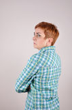 Angry and nervous woman. Profile of an angry and nervous woman with crossed arms Stock Photography