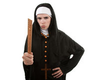 The Angry Nun. Angry Young Catholic nun pointing with a ruler royalty free stock image