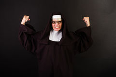 Angry Nun with fists in the air Stock Photo