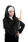 Angry Nun with Ruler. Young, angry Catholic nun lwith ruler in hand on a white background Stock Photography